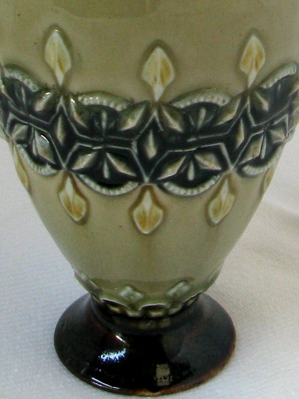 A Doulton Lambeth Glazed Jug Of Ewer Form With Pinched